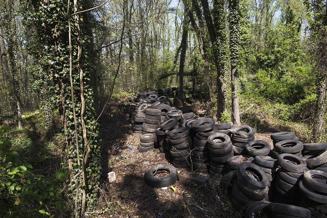 Stacks of illegally dumped tires.