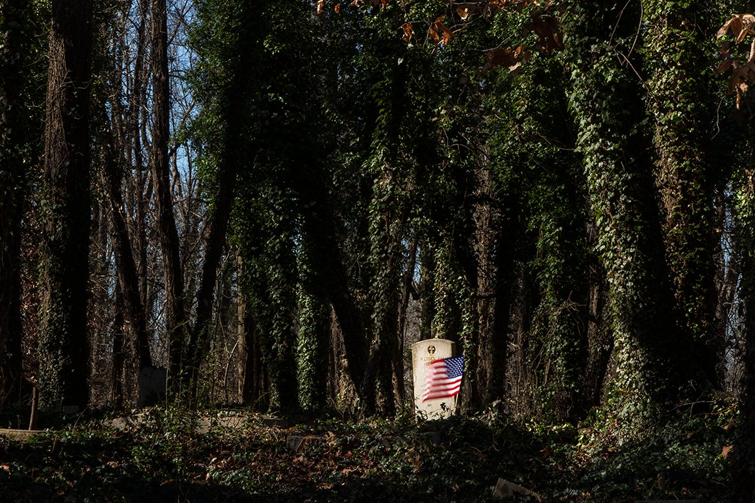 Wide evening shot of one marker with an American flag.
